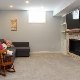 Sitting Area in the Basement with Fireplace and TV