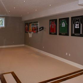 Empty Basement with Baseball Hoop