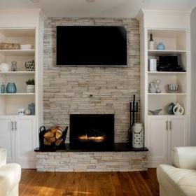 Built-in Fireplace with White Shelves