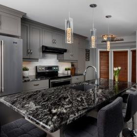 Marble Countertop with Grey Kitchen Cupboards