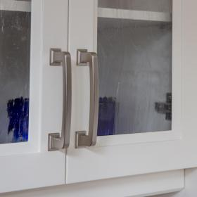 White Cupboards with Silver Hardware