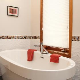 Gorgeous Soaker Tub with White Title Walls